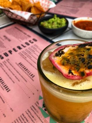Lilikoi cocktails, guacamole, and spicy chorizo tacos at Superloco